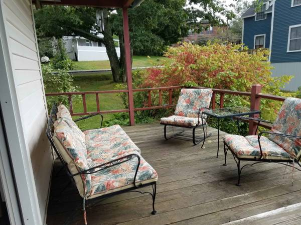 [Side porch sitting area]